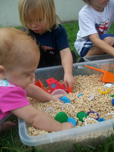 Using Cheerios as a sensory play bin.
