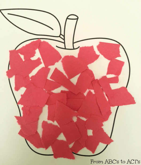 Ripping red paper and gluing to an apple page for red week in tot school.